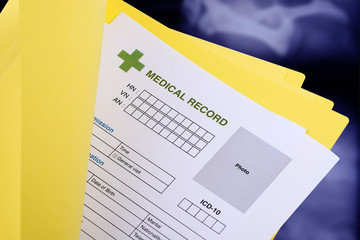 Blank medical record in yellow folder.