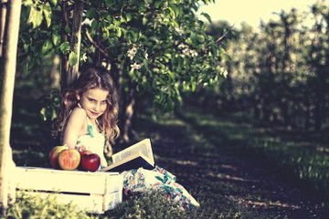 Pensive young girl reading a book