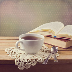 Cup of tea on crochet doily and vintage books