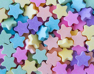Milk Tablet Candy colorful stars, many of which are edible