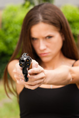 Angry Beautiful Brunette Woman Points Loaded Handgun Defence