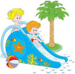 Little girl and boy sliding down from a waterslide