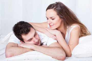 Caring woman and sleeping man