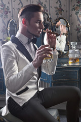 Gentleman with cigar and whisky in the nightclub