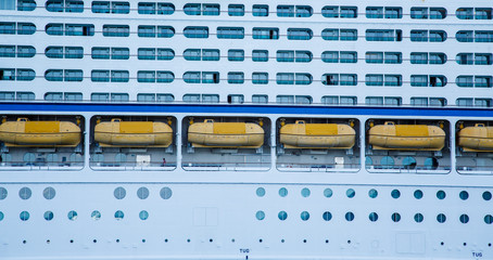 Yellow Life Boats Between Balconies and Portholes