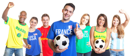French soccer fan with football showing thumb up with other fans