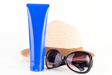suntan cream, sunglasses and hat isolated on white