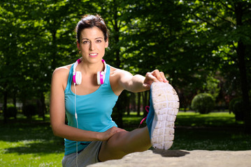 Woman stretching leg outdoor