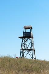 Watchtower in grass
