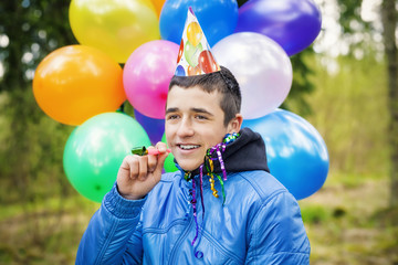 Teen with balloons in birthday party at outdoors