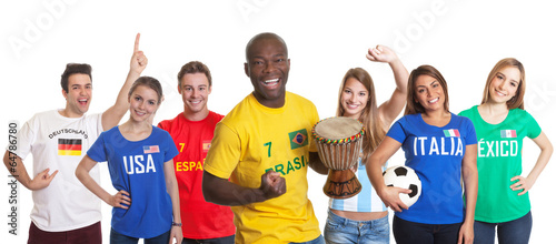 Cheering brazilian football fan with drum and other fans
