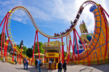 Colorful roller coaster in Prater amusement park at Vienna