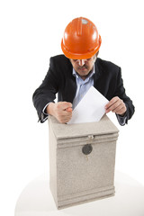 worker putting letter in mailbox,showing a fig sign