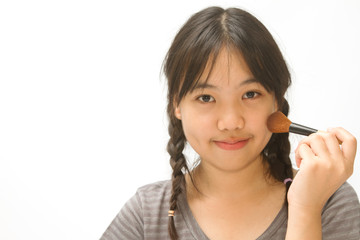 a asian smiling girl with make-up brushes