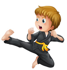 A young boy showing his karate moves