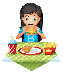 A hungry girl eating at a fastfood restaurant