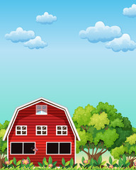 A red barnhouse near the trees