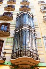 Balconies in old house in Barcelona, Spain