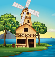 A farmhouse with a windmill