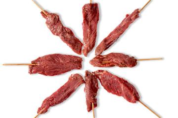 Arrangement of lean tender uncooked beef kebabs