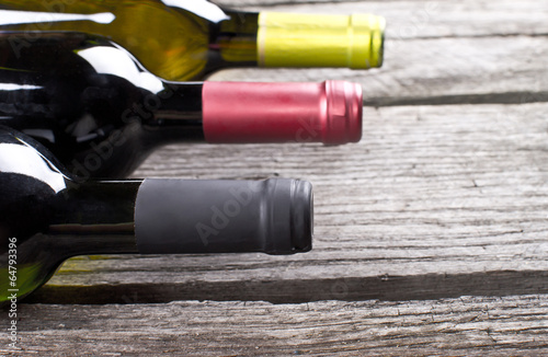 Wine bottles on a wooden table Poster