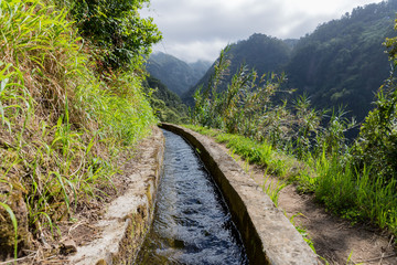 Levada, irrigation canal with hiking path at Madeira, Portugal