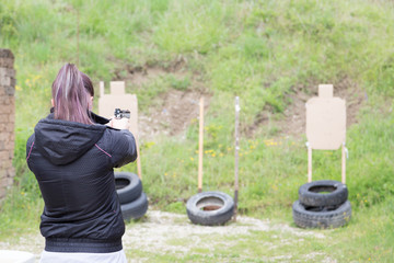 Girl Practicing at the Shooting Range