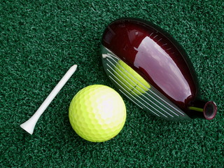 golf tee ball and club