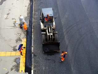 Laying asphalt pavement on the road in Moscow