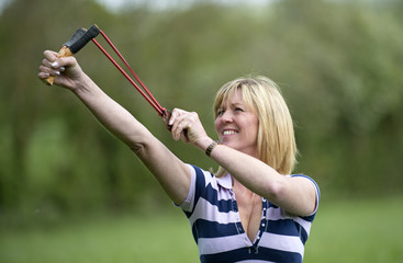 Woman firing a catapult
