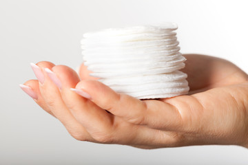 Hand with cotton pads
