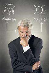 Senior man finding a solution