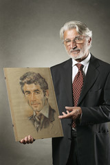 Old man shows his portrait when he was a young man