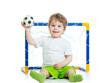 kid football player holding soccer ball