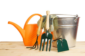 Gardening still life with various tools over white background