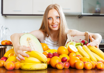 housewife with fresh fruits at  kitchen