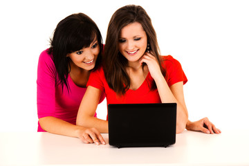 beautiful young women studying with the laptop