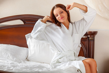 woman in bathrobe waking up