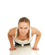 Young sport woman doing push up exercise