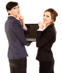 secret, two young business women with laptop