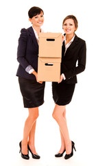 two happy young business women with carton boxes