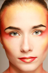 beautiful make up of bright lips, isolated on grey background