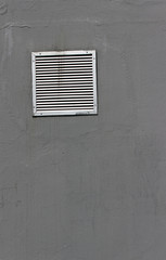 Vent window on gray  wall as background