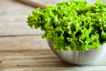 lettuce salad in metal bowl