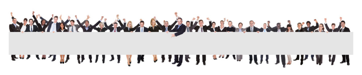 Excited Businesspeople With Blank Billboard
