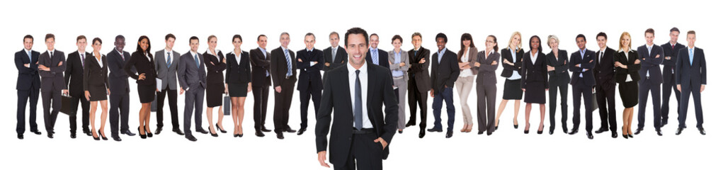 Portrait Of Confident Businessman With Team