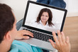 Man Video Conferencing With Woman
