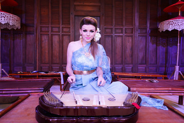 European Woman Playing Thai Musical Instrument Dulcimer
