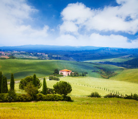 House, trees and background of Tuscany landscape