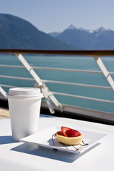 Alaska - Delight With A Strawberry Mini Tart And Hot Drink